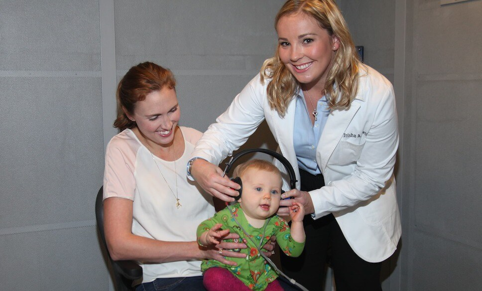 Dr. Trisha Muth Conducting Hearing Test on Young Child