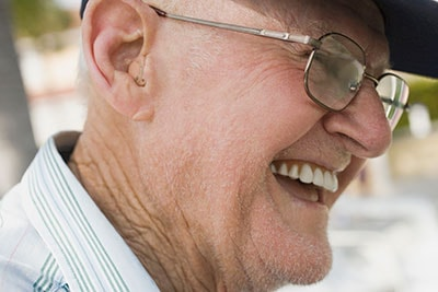 Senior Man Wearing a Digital Hearing Aid